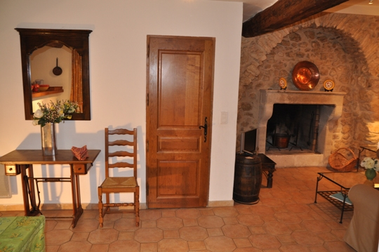 charming arched fireplace in the villa La Bergerie at Moulin de la Roque, Noves, close to Saint-Remy