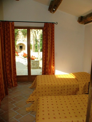 Provencal Mas, Mas des Oliviers - room Groundfloor level, access to the terrace. King or two twins. traditional beam
